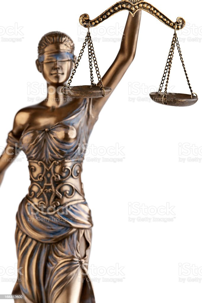 A statute of Themis holding a balance stock photo