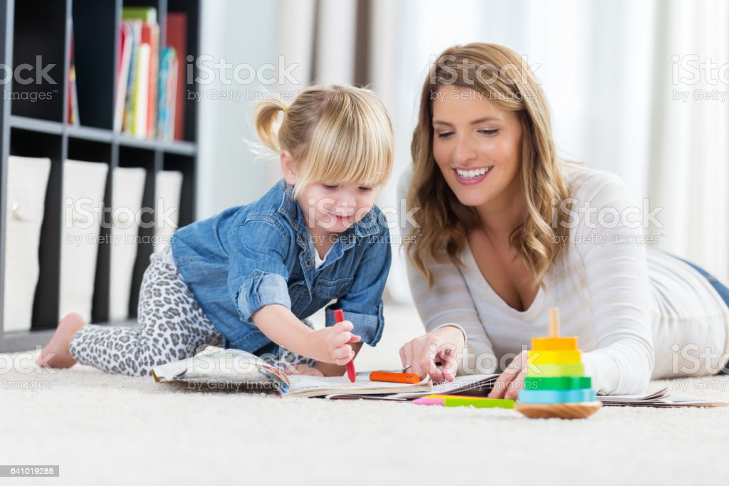 Stay at home mom colors with toddler girl stock photo