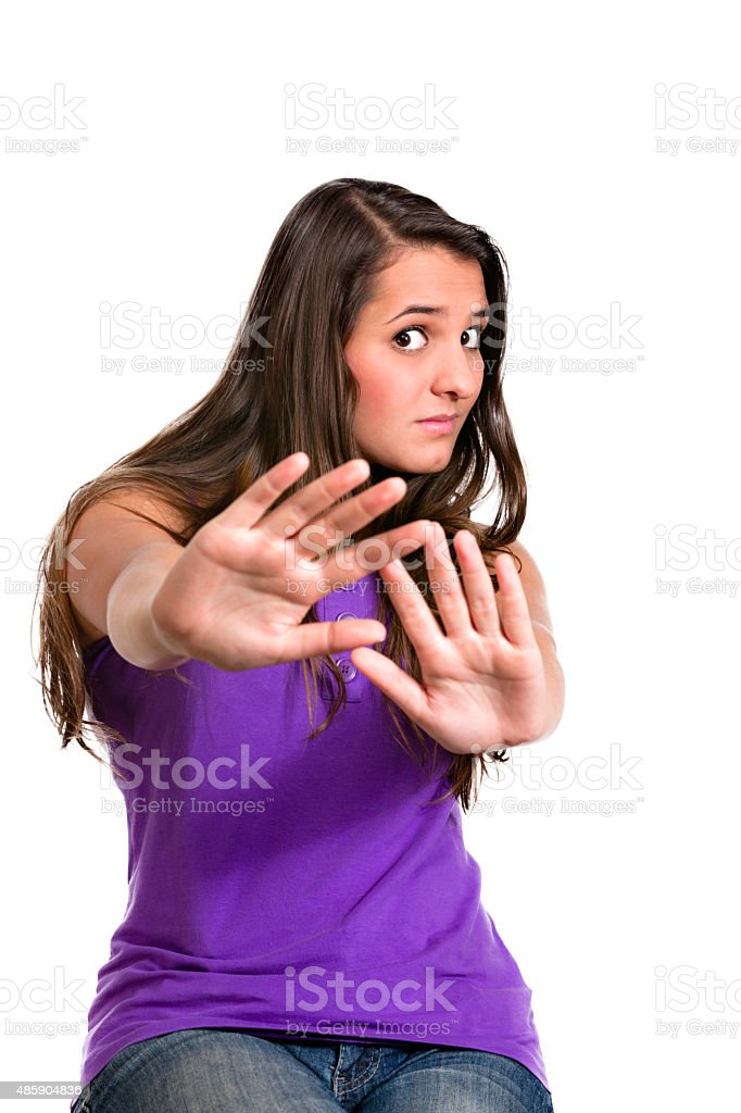 Stay away or stop gesturing. Displeased. Hispanic young woman stock photo
