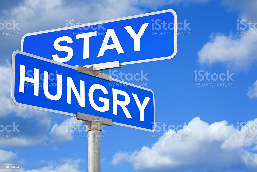 Stay Hungry Street Intersection Sign royalty-free stock photo