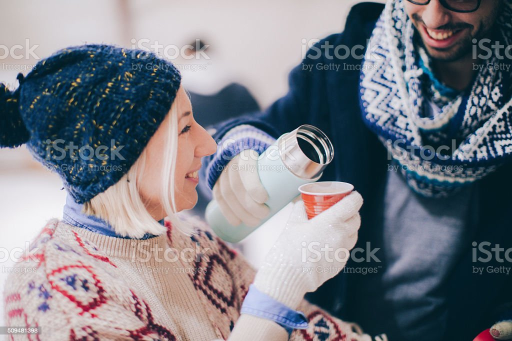 Stay warm on ice-skating rink stock photo