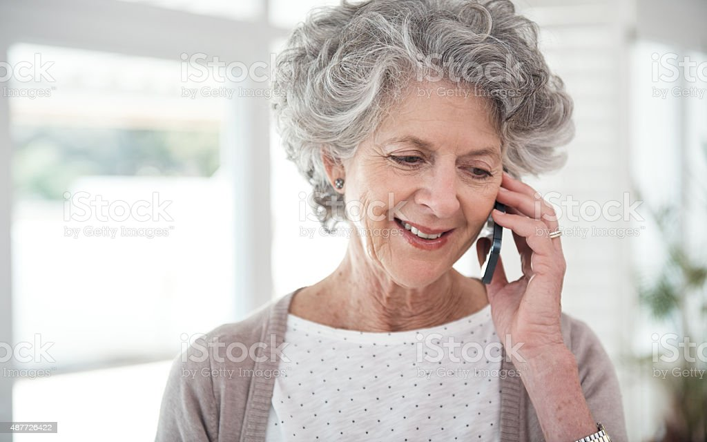 Staying connected to her loved ones stock photo