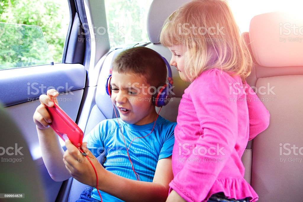 Staying entertained on their travels stock photo