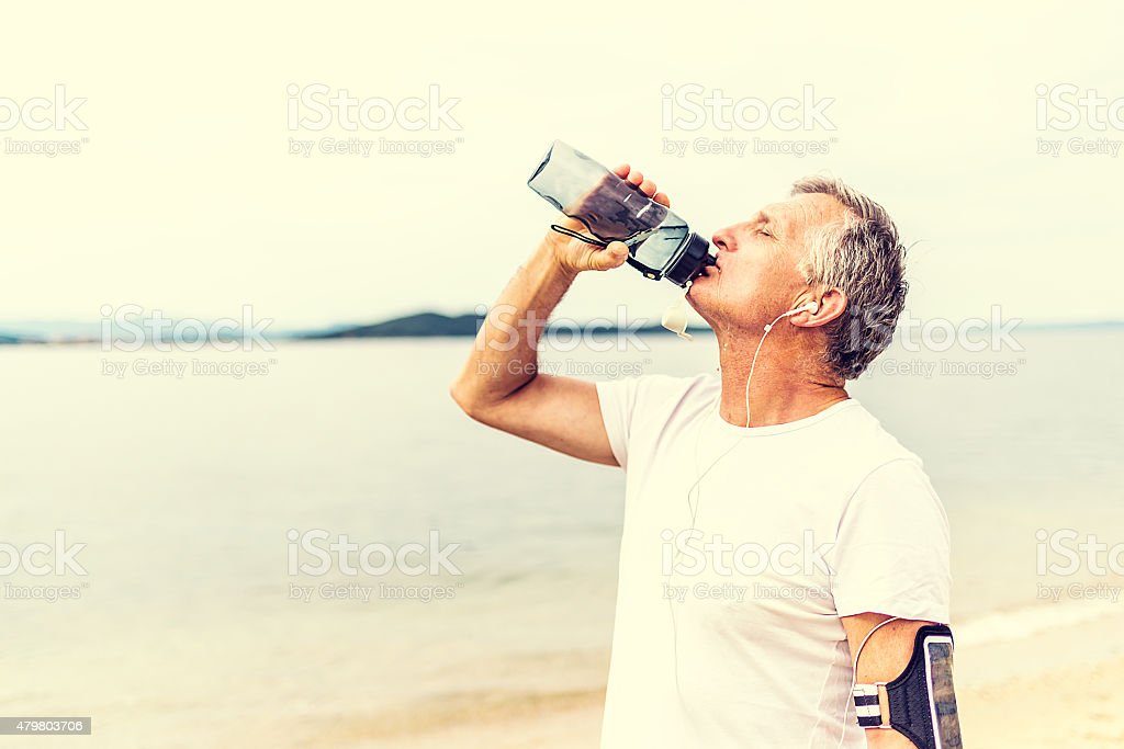 Staying hydrated  during exercise stock photo