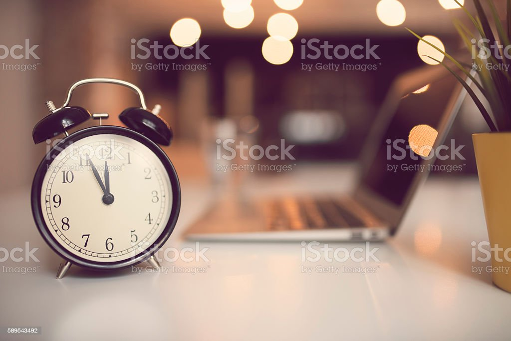 Staying late at working desk stock photo