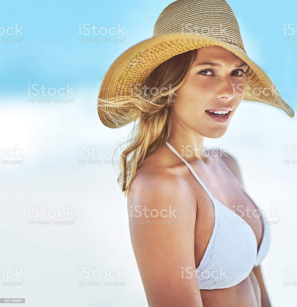 Staying safe from the summer sun with a gorgeous sunhat stock photo