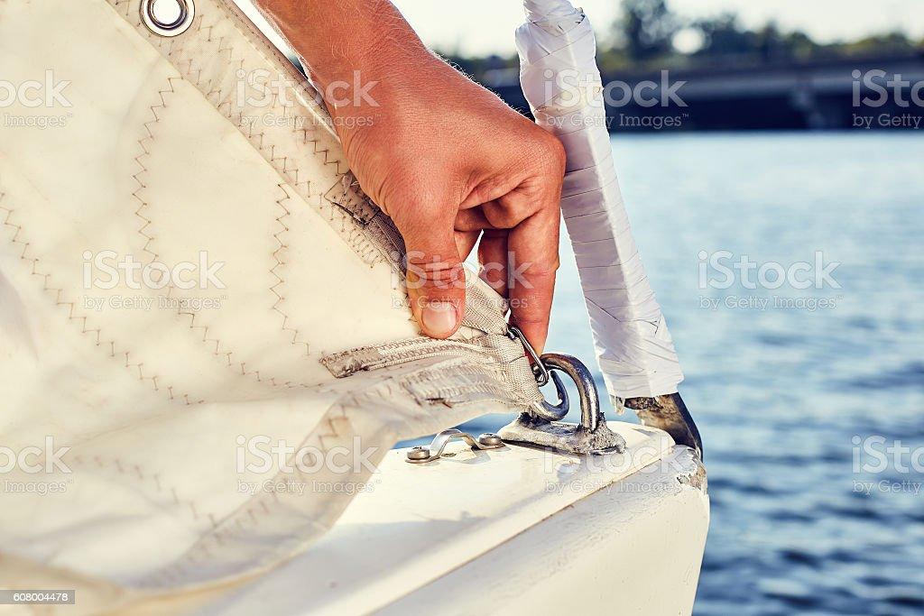 Staysail's carbine hooks on yacht stock photo