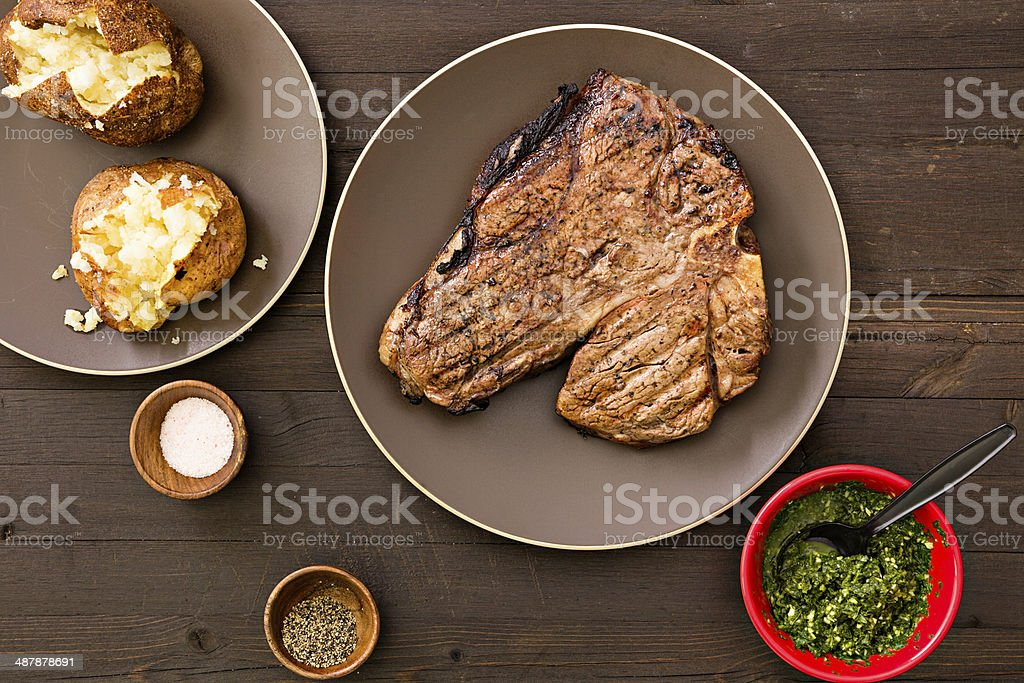 Steak And Baked Potatoes stock photo