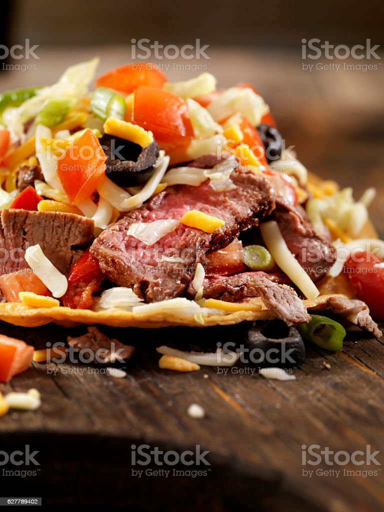 Steak and Cheese Tostada stock photo