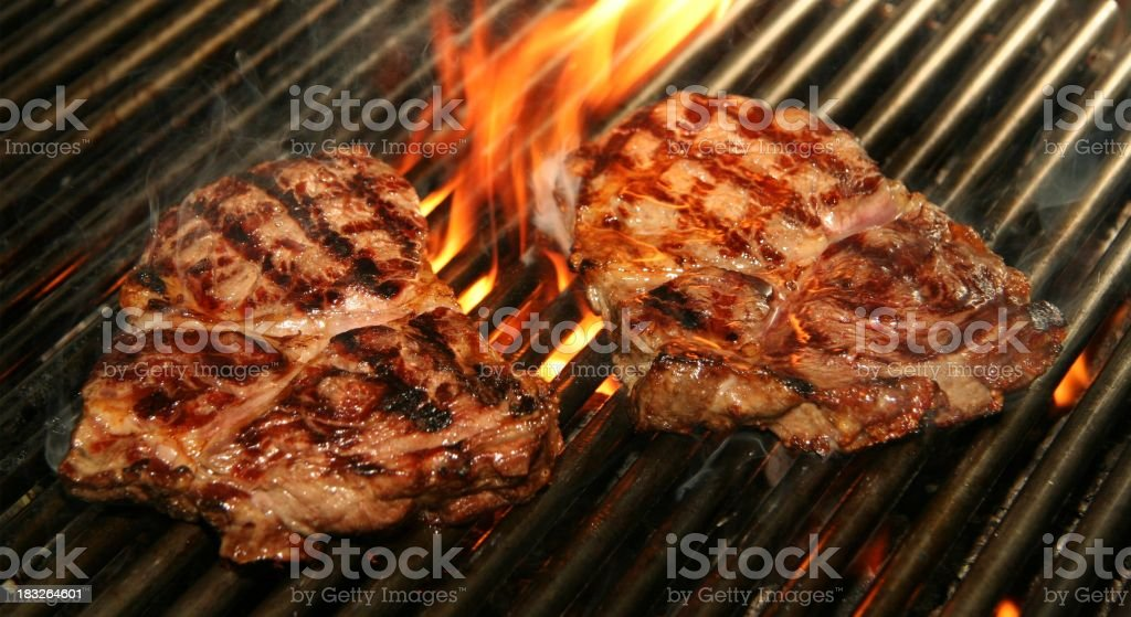 steak and fire stock photo