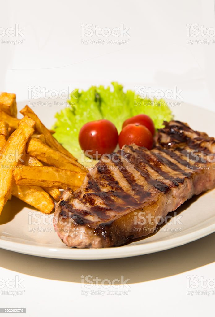 Steak and french fries stock photo