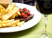 steak and fries with a glass of red wine