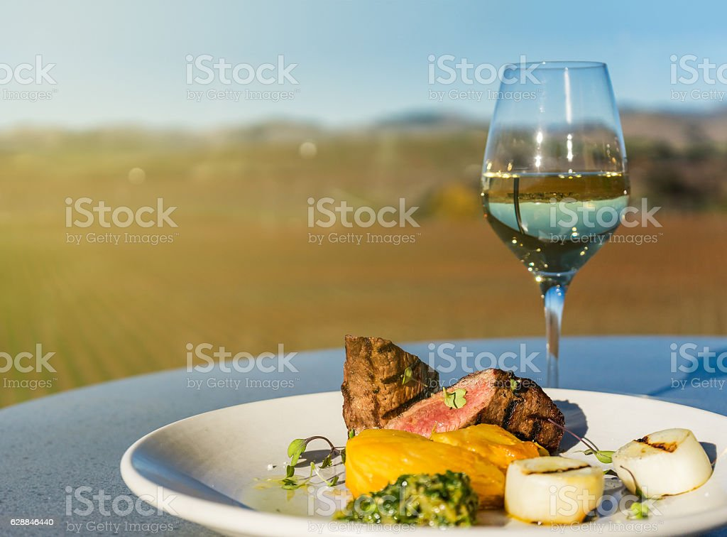Steak and glass of white wine stock photo