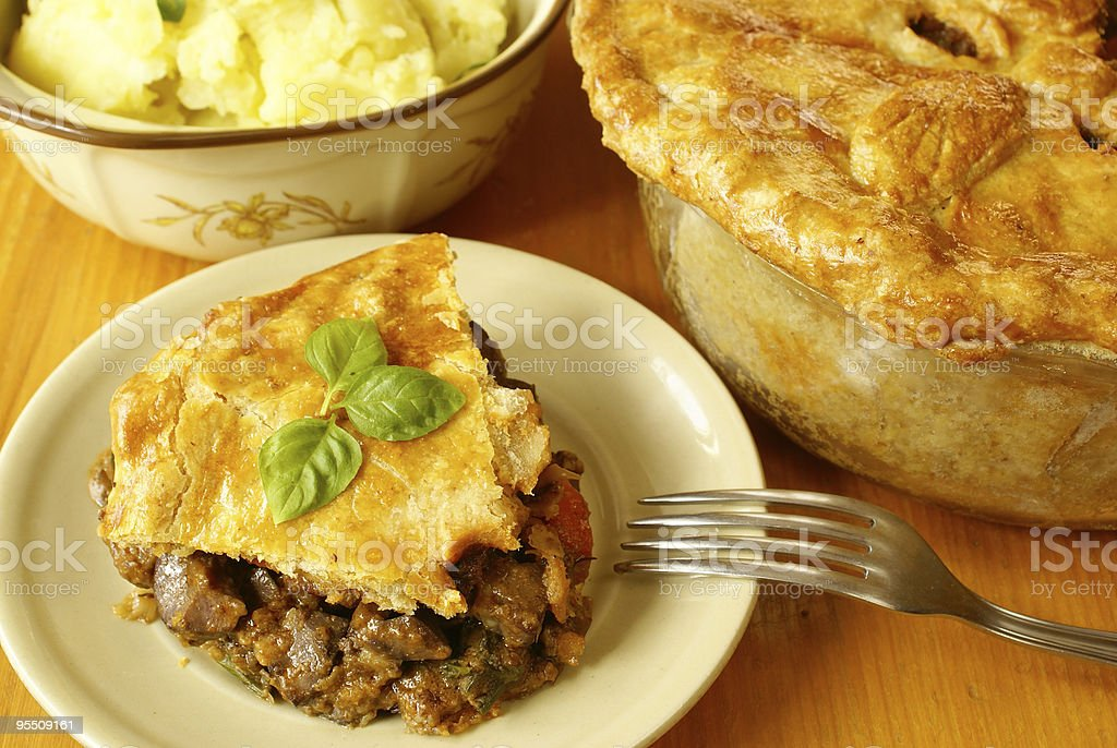 Steak and kidney pie served on a plate stock photo