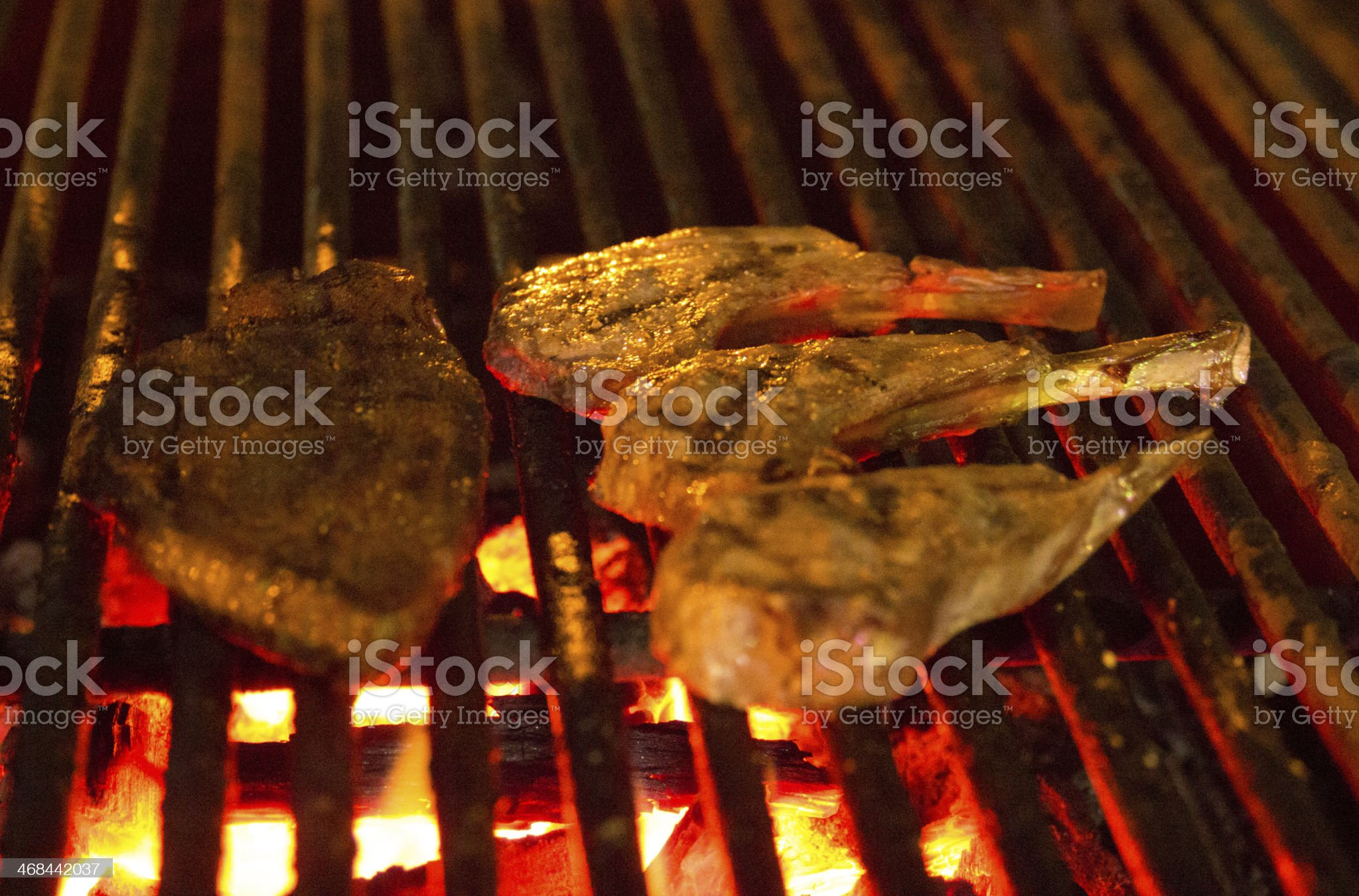 Steak and lamb chops on BBQ royalty-free stock photo