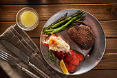 steak and lobster dinner flat lay composition