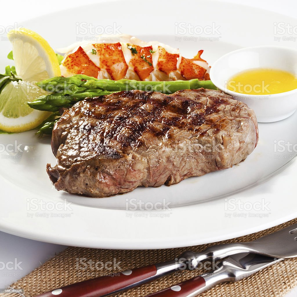 Steak and lobster dinner stock photo
