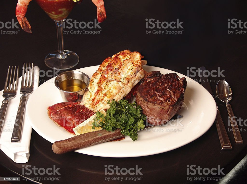 steak and lobster dinner royalty-free stock photo
