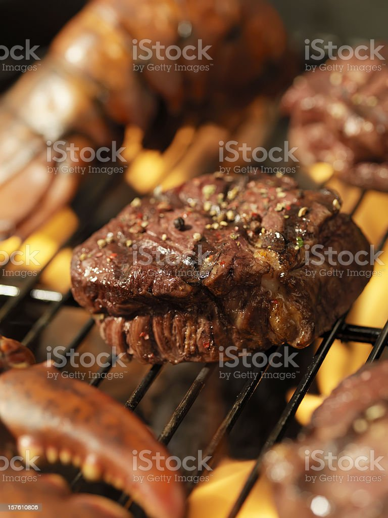 Steak and Lobster on an outdoor BBQ royalty-free stock photo