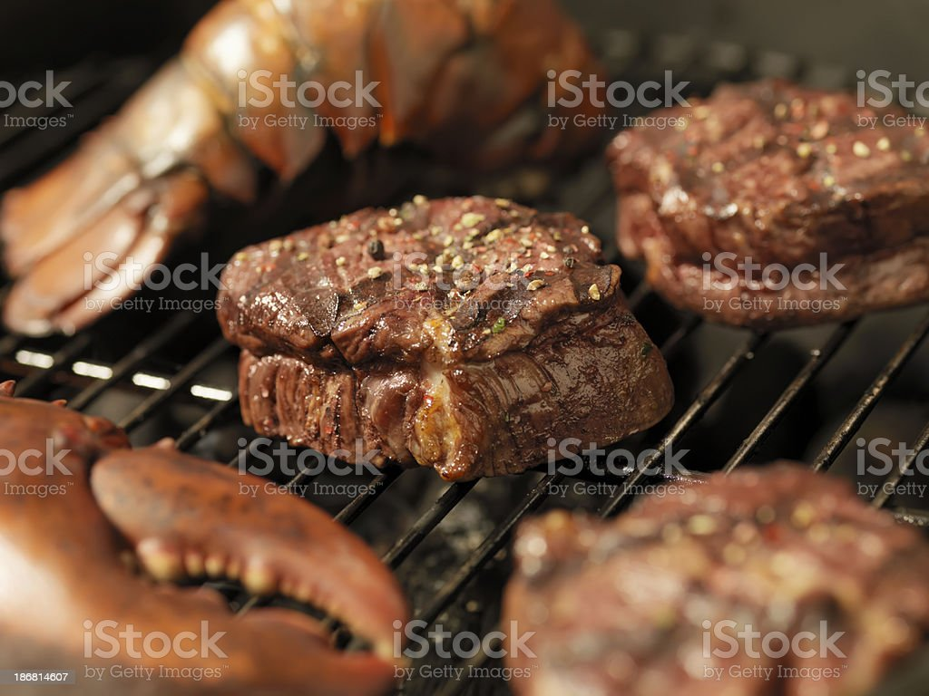 Steak and Lobster on an outdoor BBQ stock photo