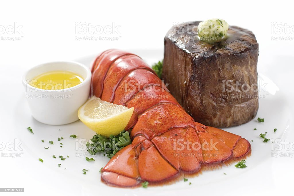 A steak and lobster with lemon royalty-free stock photo