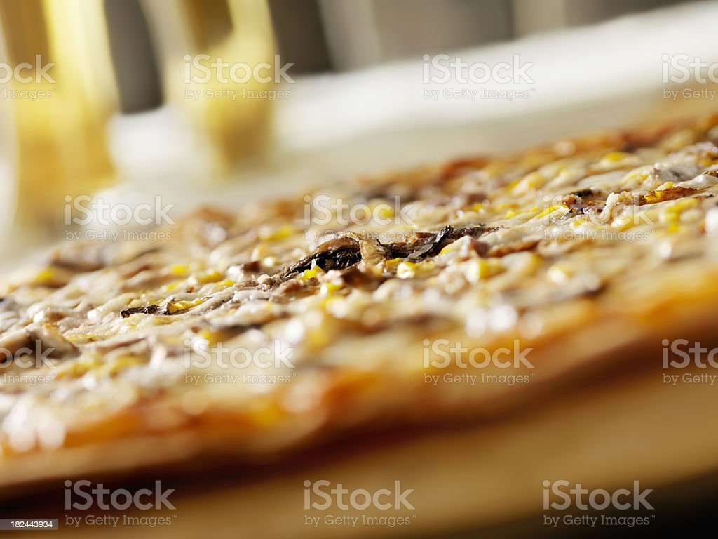 Steak and Mushroom Pizza with a Beer royalty-free stock photo