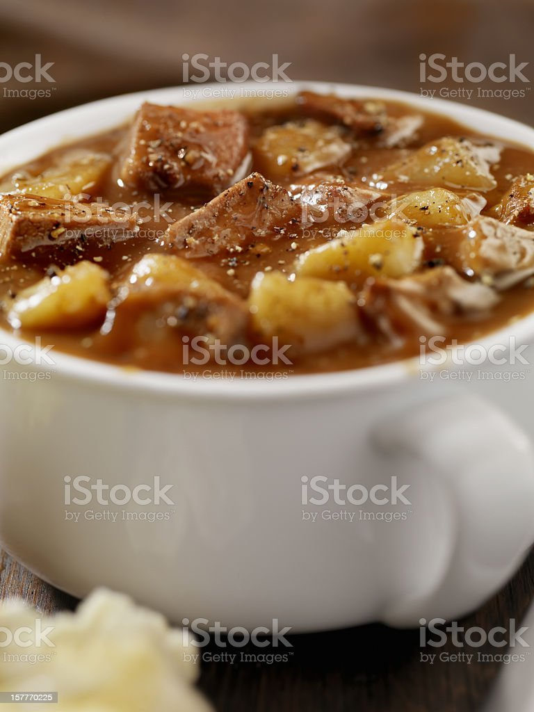 Steak and Potato Stew with Freshly Baked Biscuits stock photo