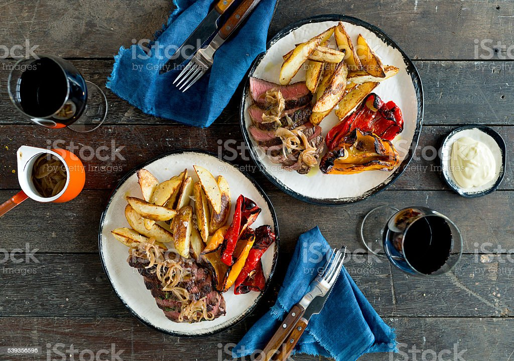 Steak and roasted vegetable dish stock photo