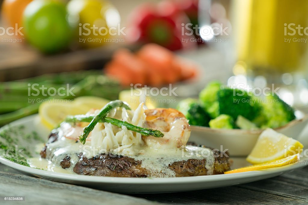 Steak and shrimp in a lemon butter sauce stock photo