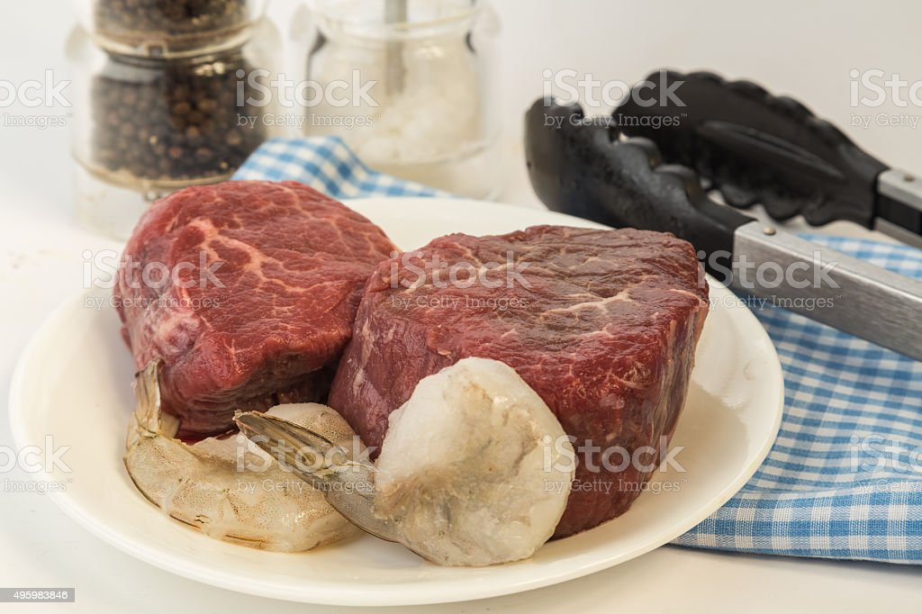 Steak and Shrimp prepared for Grilling stock photo
