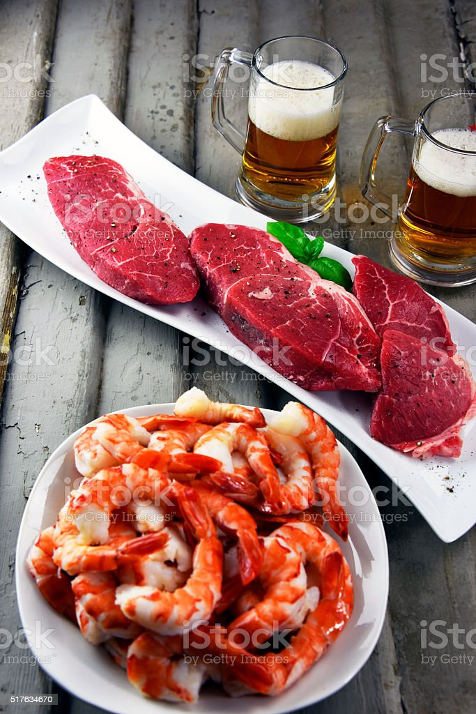 Steak and shrimp with craft beer royalty-free stock photo