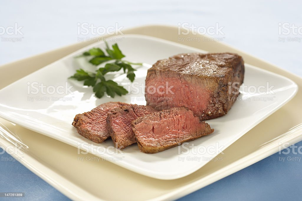 Steak and slices on a plate royalty-free stock photo