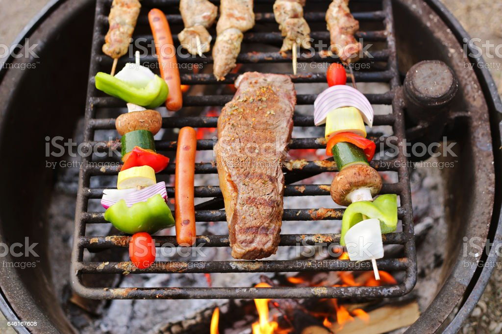 Steak and Vegetable Shish Kabobs Cookin on Fire Grill stock photo