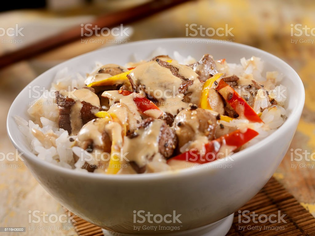 Steak And Vegetable Stir Fry with Rice and Steak Sauce stock photo