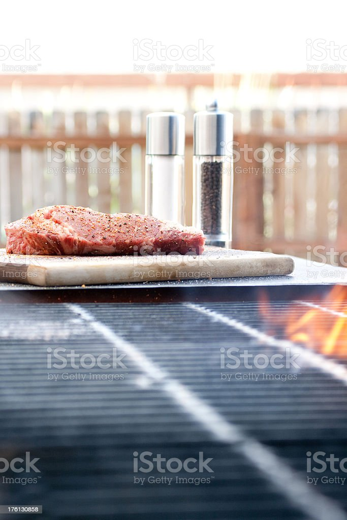 Steak beside the grill stock photo