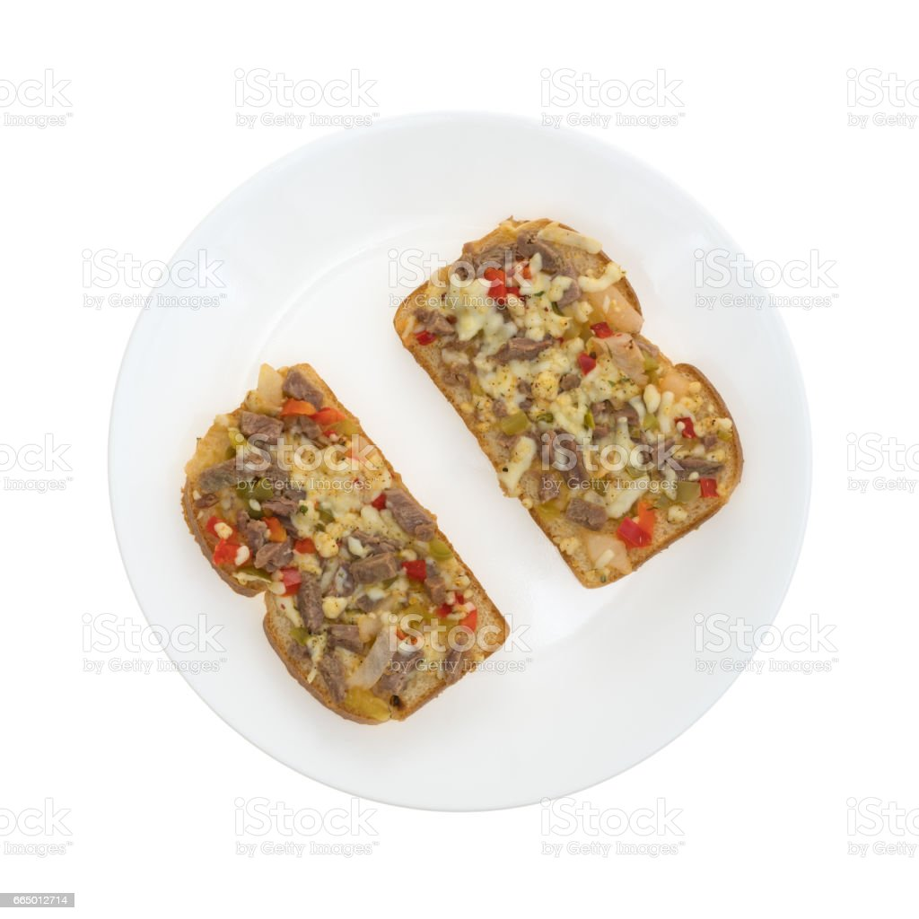 Steak cheese and vegetable sandwich on a plate stock photo