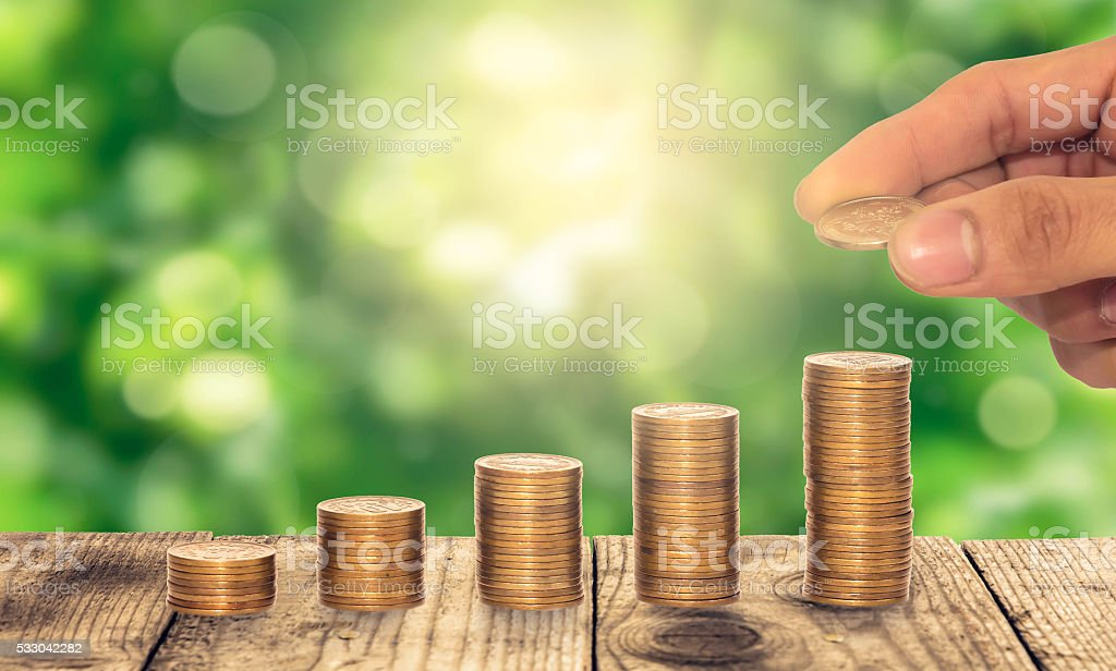 Steak coins instead of growing on a green background stock photo