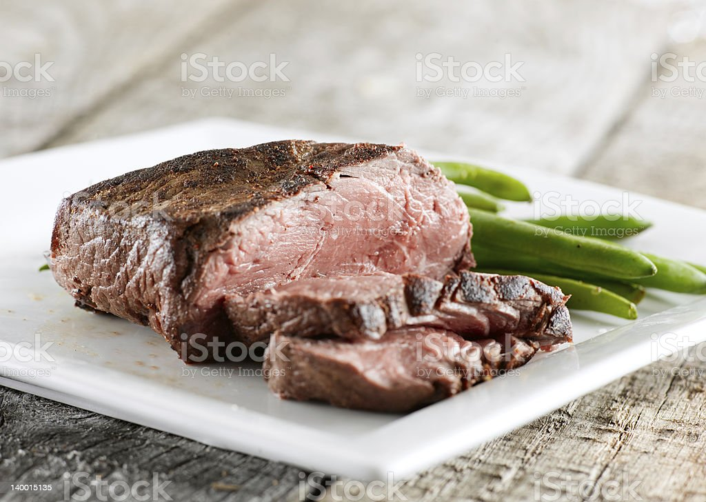 steak cooked rare with greenbeans stock photo