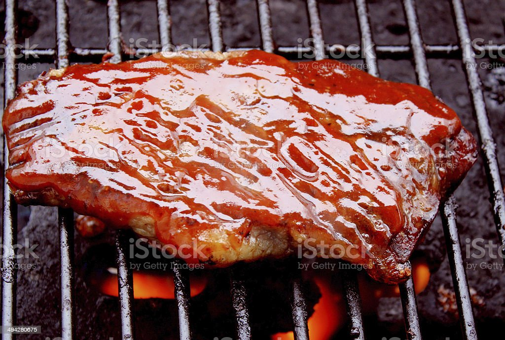 Steak Cooking On The Barbecue stock photo