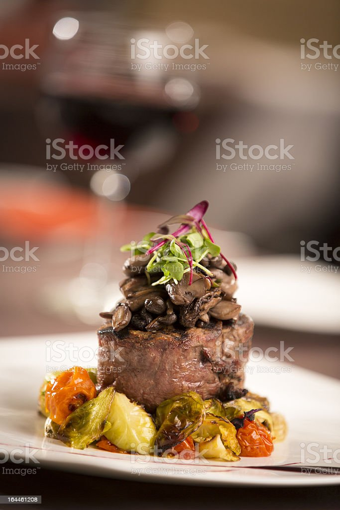 Steak Filet with Mushrooms and Artichokes royalty-free stock photo