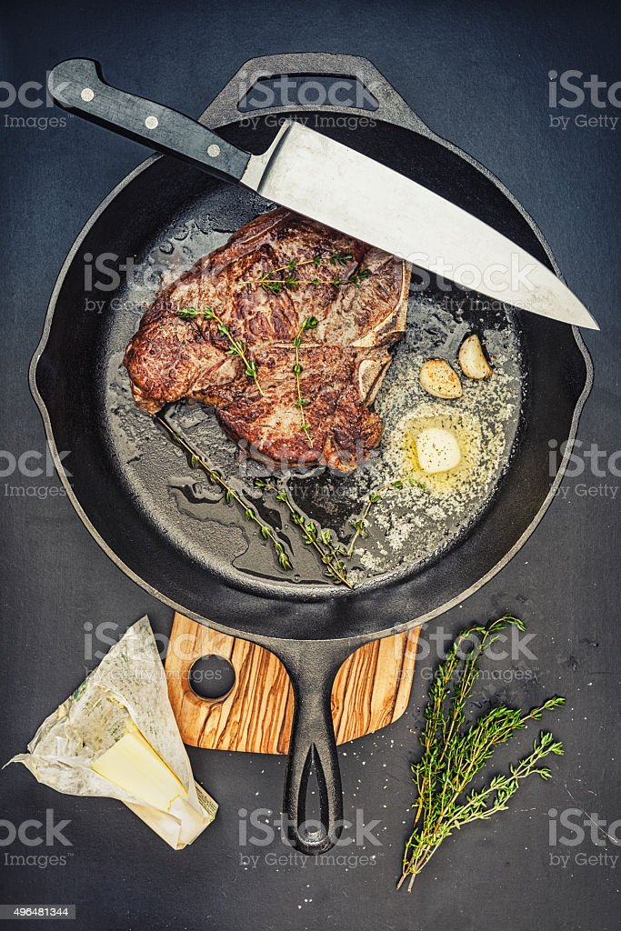 Steak in a cast iron pan stock photo