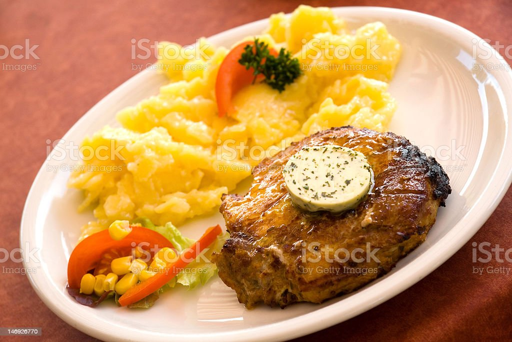 steak of pork,grilled-with potato salad royalty-free stock photo