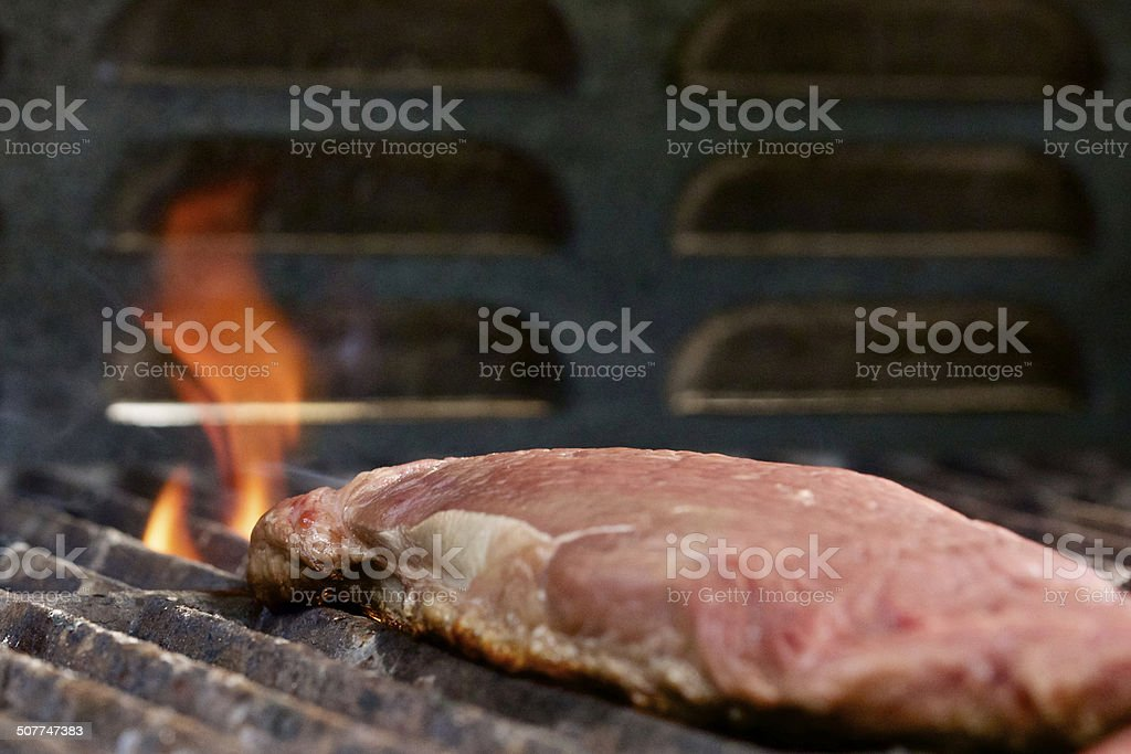 Steak on a Flaming Grill stock photo