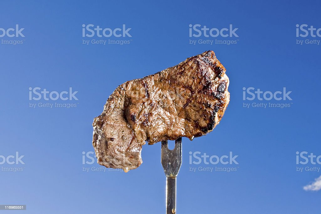 Steak on a Fork royalty-free stock photo