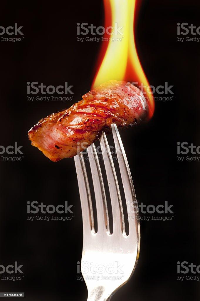 Steak on a Fork. stock photo