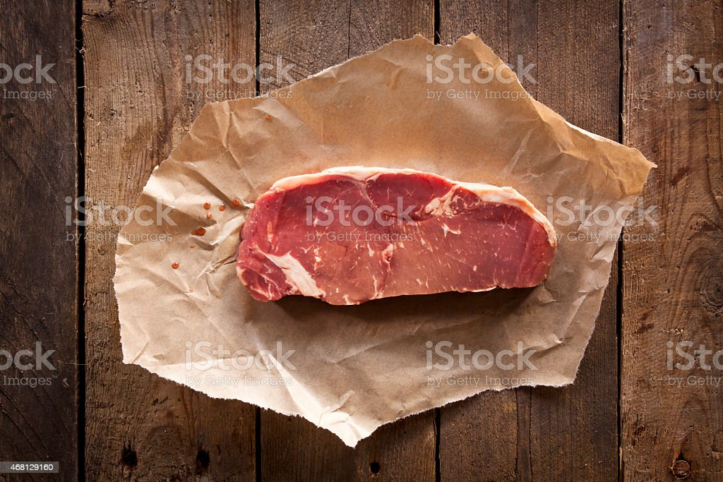 Steak on Rustic Wood stock photo