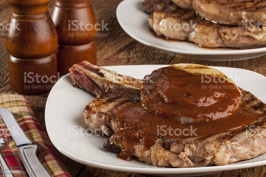 Steak, onion and sauce royalty-free stock photo