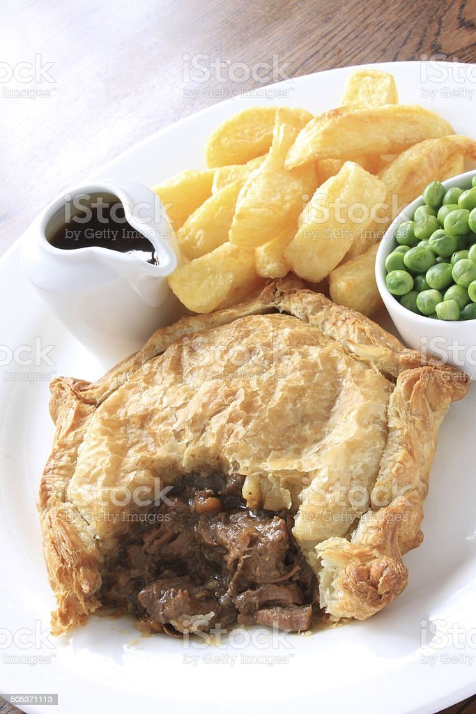 steak pie with chips and peas meal stock photo