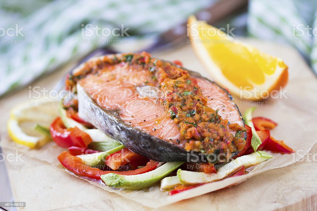 Steak red fish salmon on vegetables, zucchini and paprika stock photo