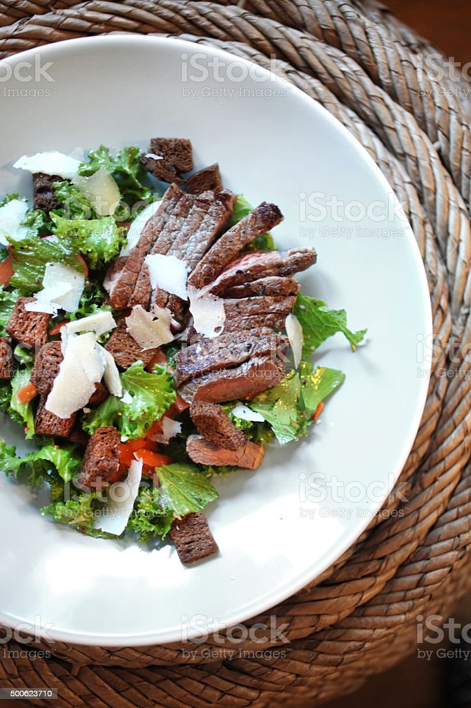 Steak salad with rye croutons stock photo
